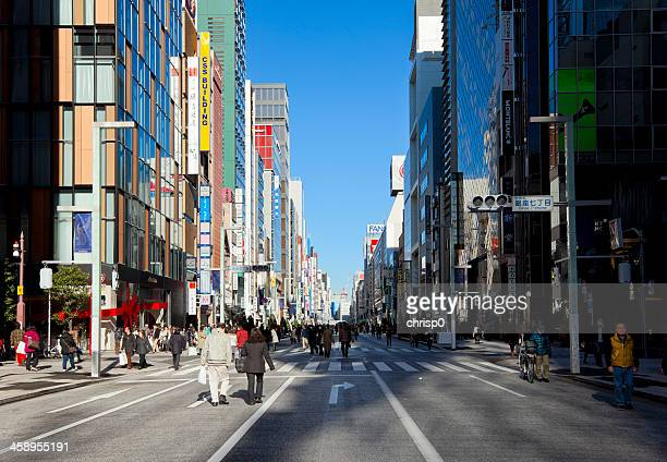 pedestrians on chuo dori in ginza, tokyo - chuo dori street stock photos and pictures