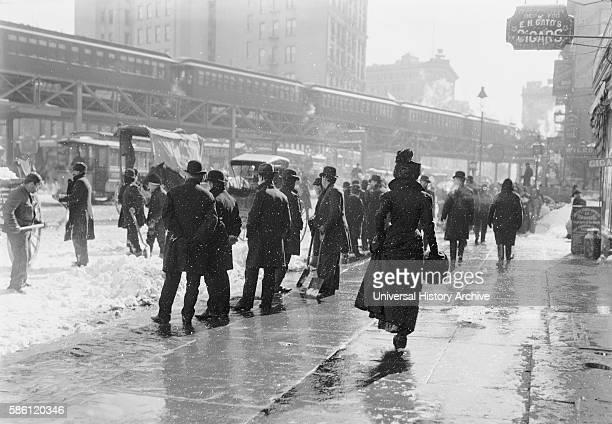 Pedestrians on Street During Blizzard New York City USA circa 1899