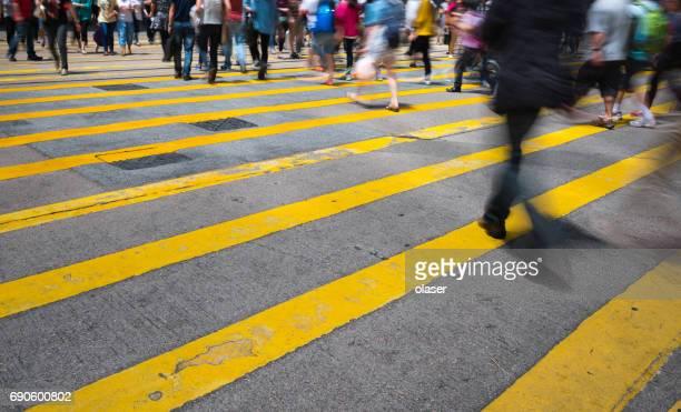 pedestrians on street in hong kong - strisce pedonali foto e immagini stock
