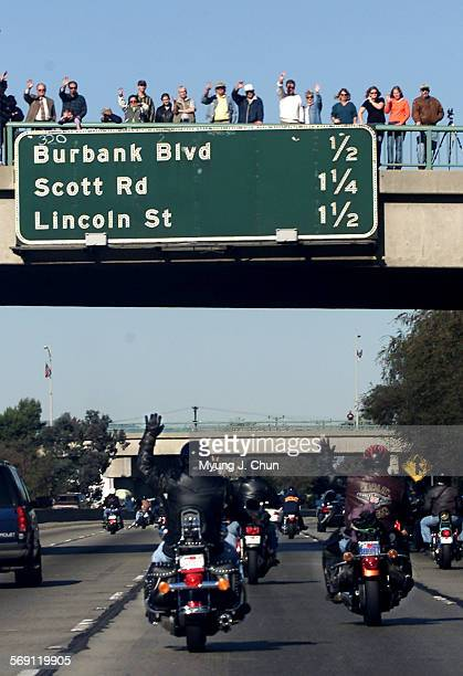 Pedestrians on the Olive Avenue overpass in Burbank wave to motorcyclists on the northbound I–5 freeway taking part in the 17th annual Love Ride...