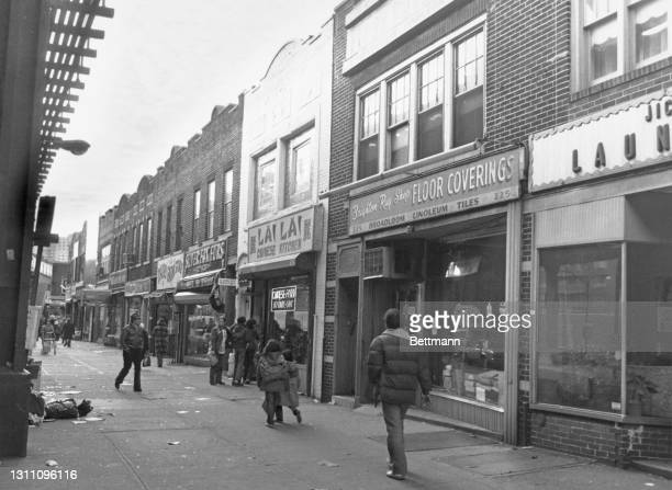 Pedestrians on the sidewalk in front of the Lai Lai Chinese Kitchen, and the Brighton Rug Shop, owned by Vincent Gambale, in Brooklyn borough of New...