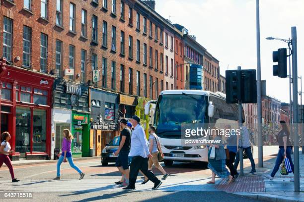 pedestrians on the streets of cork, ireland - cork city stock pictures, royalty-free photos & images