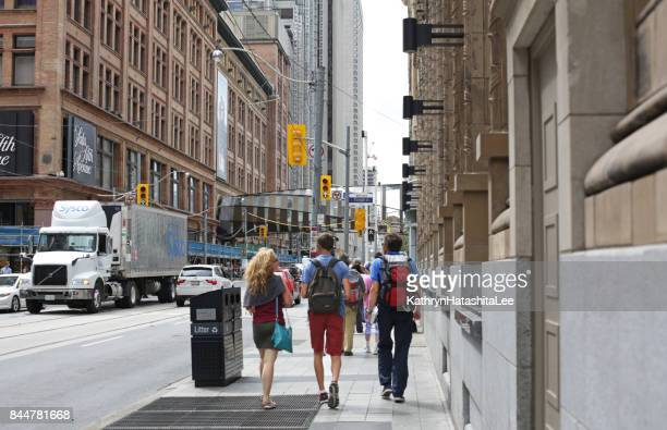 Pedestrians on Toronto's Queen Street at Yonge Street in Summer