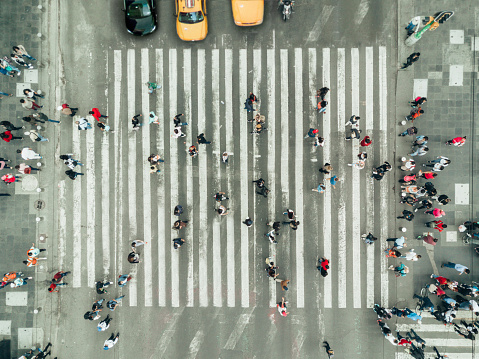 Pedestrians on zebra crossing, New York City 1048763642