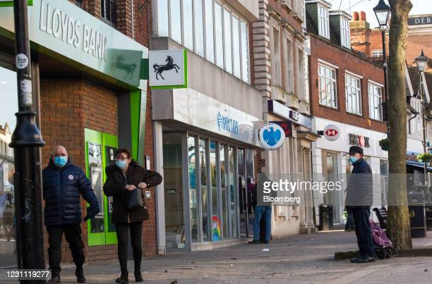Pedestrians outside branches of a Lloyds Banking Group Plc bank, a Barclays Bank Plc bank, a NatWest Group Plc bank, and a HSBC Holdings Plc bank in...