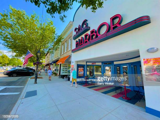 pedestrians outside sag harbor movie theatre - sag harbor stock pictures, royalty-free photos & images