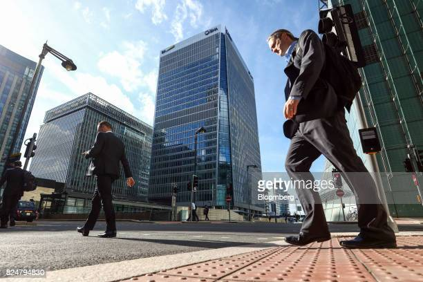 Pedestrians pass 30 Churchill Place centre which houses the European Medicines Agency in the Canary Wharf financial business and shopping district in...