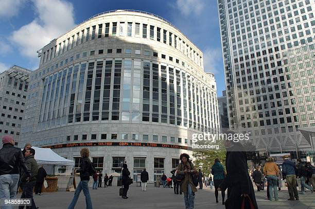 Pedestrians pass 30 South Colonnade centre where the London interbank offered rate or Libor is set daily in Canary Wharf London UK on Friday Oct 3...
