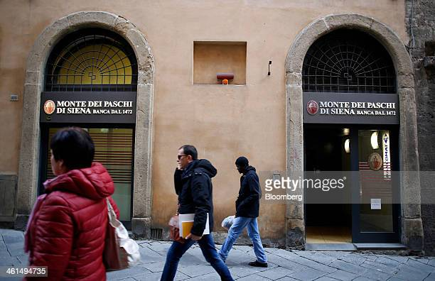Pedestrians pass a Banca Monte dei Paschi di Siena SpA bank branch in Siena Italy on Wednesday Jan 8 2014 Monte Paschi the bailed out Italian bank is...