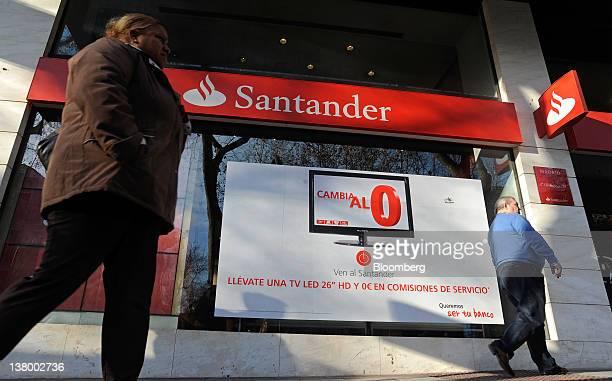 Pedestrians pass a Banco Santander SA branch in Madrid Spain on Monday Jan 30 2012 Banco Santander SA Spain's biggest lender said fourthquarter...