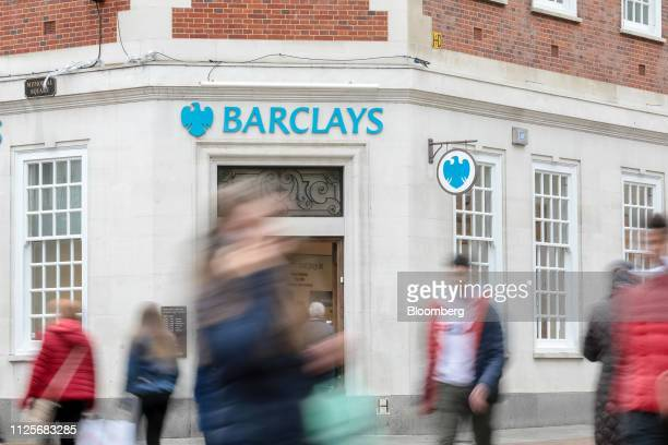 Pedestrians pass a bank branch of Barclays Plc in London, U.K., on Monday, Feb. 18, 2019. Barclays, along with HSBC Holdings Plc and Lloyds Banking...