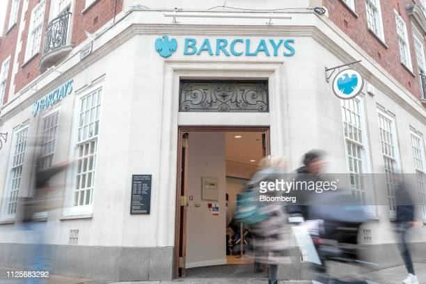 Pedestrians pass a bank branch of Barclays Plc in London UK on Monday Feb 18 2019 Barclays along with HSBC Holdings Plc and Lloyds Banking Group Plc...