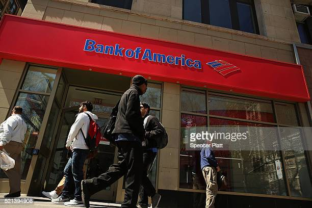 Pedestrians pass a Bank of America branch in lower Manhattan on April 15 2016 in New York City As global markets continue to be rattled by the fall...