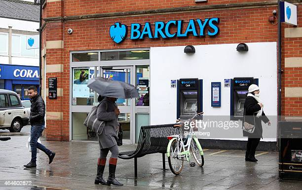 Pedestrians pass a Barclays bank operated by Barclays Plc in London UK on Thursday Feb 26 2015 Barclays will shrink its 2014 bonus pool more than 17...
