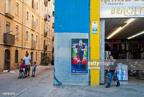 Pedestrians pass a beach souvenir store in the Barceloneta neighborhood of Barcelona, Spain, on Tuesday, June 5, 2012. The Bank of Spain said May 29...