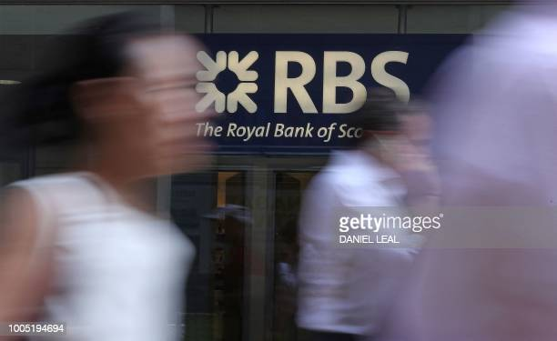 Pedestrians pass a branch of a Royal Bank of Scotland bank branch in central London on July 25, 2018.