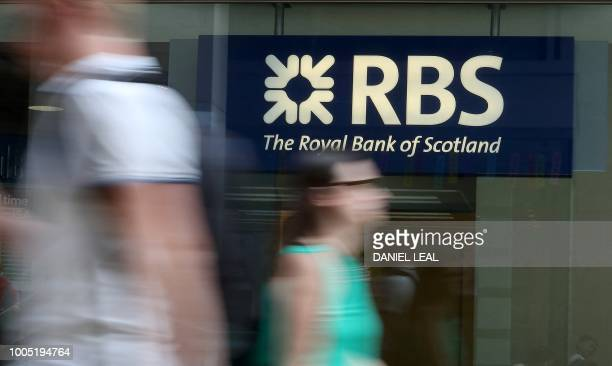 Pedestrians pass a branch of a Royal Bank of Scotland bank branch in central London on July 25 2018