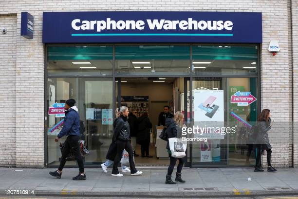 Pedestrians pass a branch of Carphone Warehouse operated by Dixons Carphone Plc in London UK on Tuesday March 17 2020 Dixons plans to close 531...