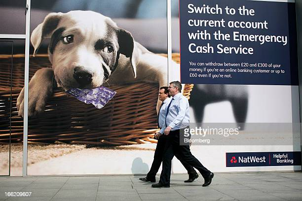Pedestrians pass a branch of NatWest bank part of the Royal Bank of Scotland Group Plc in London UK on Wednesday April 10 2013 The UK's...