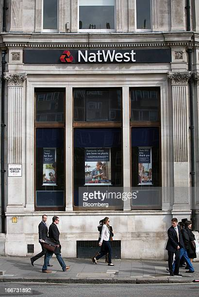 Pedestrians pass a branch of NatWest bank part of the Royal Bank of Scotland Group Plc in London UK on Tuesday April 16 2013 The UK's consumerfinance...