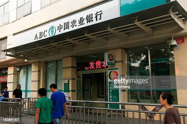 Pedestrians pass a branch of the Agricultural Bank of China Ltd in Beijing China on Tuesday Aug 28 2012 Agricultural Bank of China is expected to...