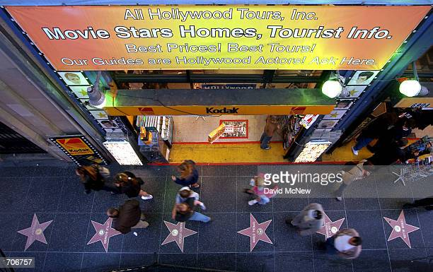 Pedestrians pass a business across the street from the Kodak Theatre which caters to tourists with momentos and Hollywood tours March 22 in Hollywood...