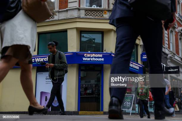 Pedestrians pass a Carphone Warehouse retail store operated by DixonsCarphonePlc in central London UK on Tuesday May 29 2018...
