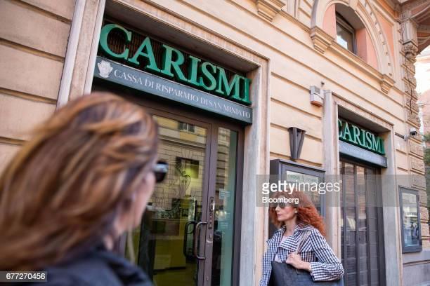 Pedestrians pass a Cassa di Risparmio di San Miniato SpA bank branch in Rome, Italy, on Tuesday, May 2, 2017. Credit Agricole SA's Italian retail...