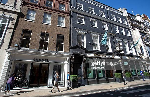 Pedestrians pass a Chanel SA fashion store, left, and a Tiffany & Co. Jewelry store on Old Bond Street in central London, U.K., on Monday, Aug. 15,...