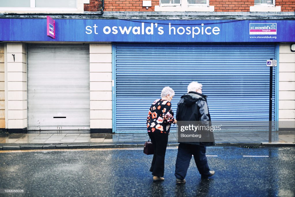 Pedestrians pass a charity shop at the former site of a Northern Rock branch in Wallsend, U.K., on Thursday, Sept. 6, 2018. The northeast of England illustrates the precarious position facing many parts of the U.K. just six months before the country is due to leave the EU. Photographer: Matthew Lloyd/Bloomberg via Getty Images