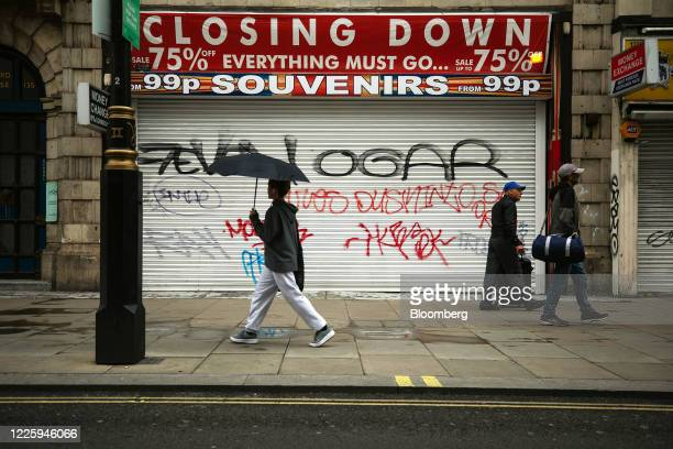 Pedestrians pass a closed and shuttered souvenir shop on Oxford Street in London, U.K., on Thursday, July 9, 2020. British shops aren't getting much...