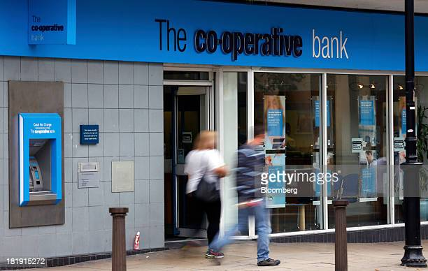 Pedestrians pass a CoOperative Bank Plc branch a unit of CoOperative Group Ltd in Bolton UK on Wednesday Sept 25 2013 The parent of Cooperative Bank...