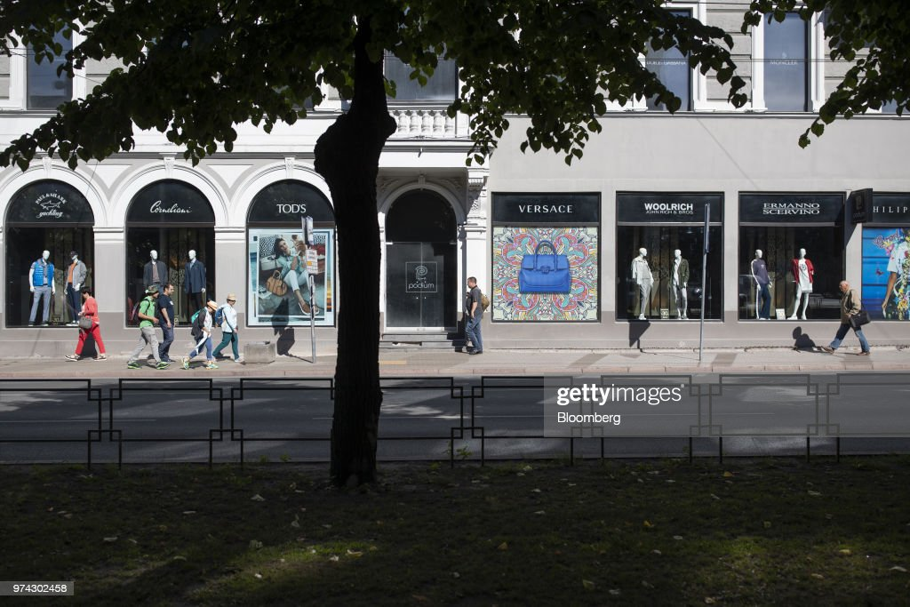 Pedestrians pass a department store's window displays for luxury fashion concessions in Riga, Latvia, on Thursday, June 14, 2018. Latvia's plans to kick out risky cash from its scandal-plagued banks are about to accelerate. Photographer: Jasper Juinen/Bloomberg via Getty Images