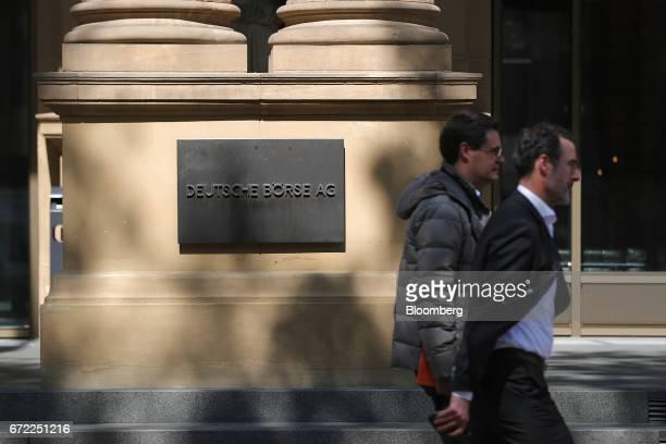 Pedestrians pass a Deutsche Boerse AG sign outside the Frankfurt Stock Exchange in Frankfurt Germany on Monday April 24 2017 Frances bonds jumped...