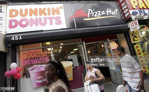 Pedestrians pass a Dunkin' Donuts and a Pizza Hut restaurant July 12 2006 in the Brooklyn borough of New York City In the battle to fight obesity New...