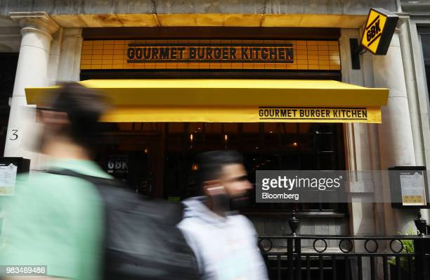 Pedestrians pass a Gourmet Burger Kitchen Ltd. Restaurant in London, U.K., on Thursday, June. 21, 2018. The rise of e-commerce, which makes up 18...