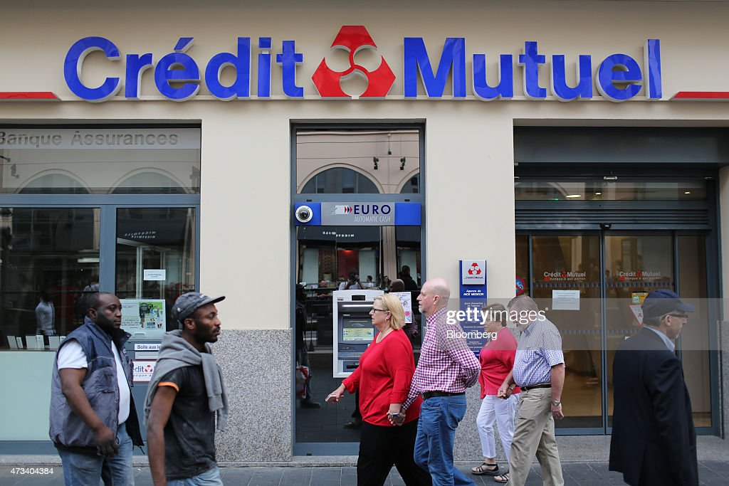 Pedestrians Pass A Groupe Credit Mutuel Bank Branch In Nice
