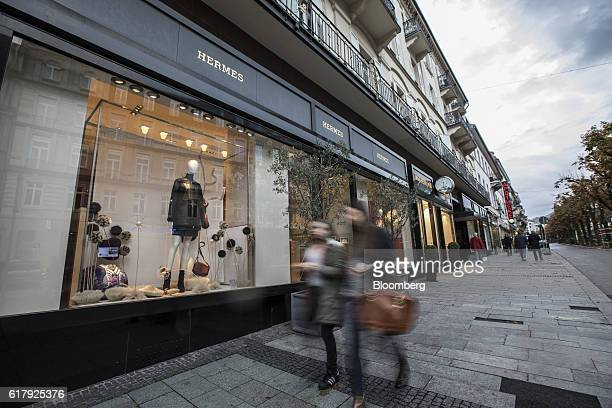 Pedestrians pass a Hermes luxury clothing store operated by Hermes International SCA in BadenBaden Germany on Monday Oct 24 2016 The world's...