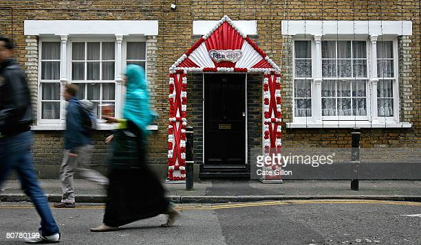 Pedestrians pass a house decorated for an Asian wedding near Brick Lane on April 19th 2008 in London England Tomorrow is the anniversary of...