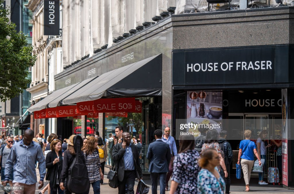 Pedestrians pass a House of Fraser store, one of the stores slated for closure, on Oxford Street, in central London, U.K., on Wednesday, June 13, 2018. U.K. department-store chain House of Fraser said it plans to shut more than half its outlets, putting 6,000 jobs at risk. Photographer: Chris J. Ratcliffe/Bloomberg via Getty Images