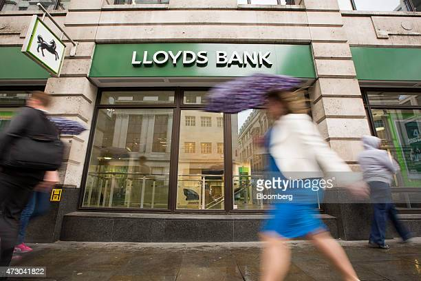 Pedestrians pass a Lloyds Bank branch a unit of Lloyds Banking Group Plc in London UK on Tuesday May 12 2015 The UK government sold about 634 million...