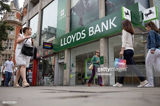 Pedestrians pass a Lloyds Bank branch a unit of Lloyds Banking Group Plc on Oxford Street in London UK on Thursday July 28 2016 Lloyds Banking Group...