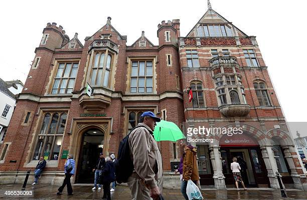 Pedestrians pass a Lloyds bank left operated by Lloyds Banking Group Plc and a Santander bank operated by Banco Santander SA in Canterbury UK on...