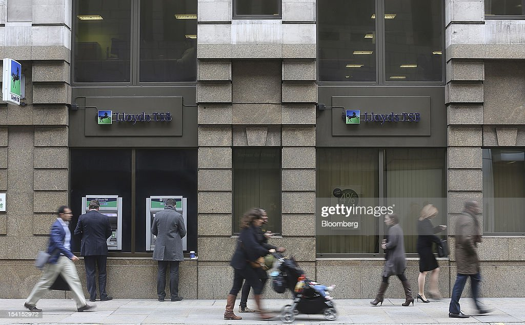 Pedestrians pass a Lloyds TSB bank branch, part of the Lloyds Banking Group Plc, in London, U.K., on Monday, Oct. 15, 2012. U.S. homeowners filed a lawsuit against 12 banks, including Lloyds Banking Group Plc, Barclays Bank Plc, and JPMorgan Chase & Co., claiming that manipulation of the benchmark Libor lending rate made their mortgage repayments more expensive. Photographer: Simon Dawson/Bloomberg via Getty Images