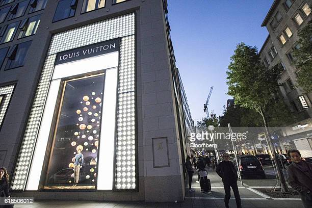 Pedestrians pass a LVMH Moet Hennessy Louis Vuitton SE boutique in Frankfurt Germany on Wednesday Oct 26 2016 The world's luxurygoods market stopped...