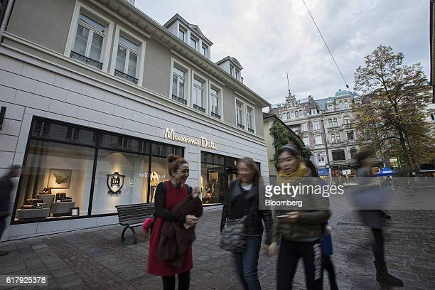 Pedestrians pass a Massimo Dutti luxury clothing store operated by Inditex SA in BadenBaden Germany on Monday Oct 24 2016 The world's luxurygoods...