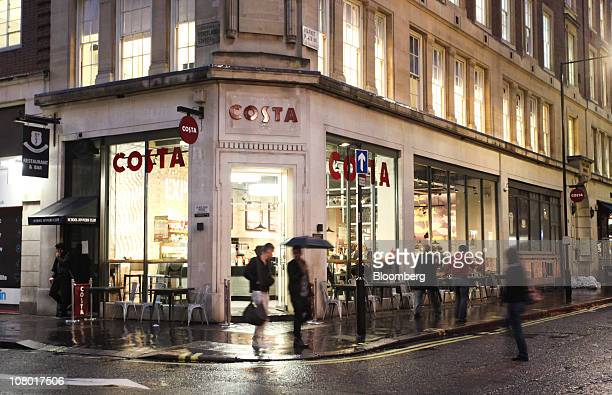 Pedestrians pass a 'Metropolitan' Costa Coffee shop in London UK on Wednesday Jan 12 2011 Whitbread Plc may be considering buying Coffee Nation a UK...
