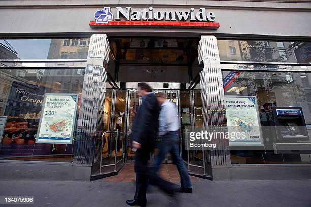 Pedestrians pass a Nationwide Building Society branch in London UK on Thursday Nov 24 2011 Nationwide Building Society the UK's largest customerowned...