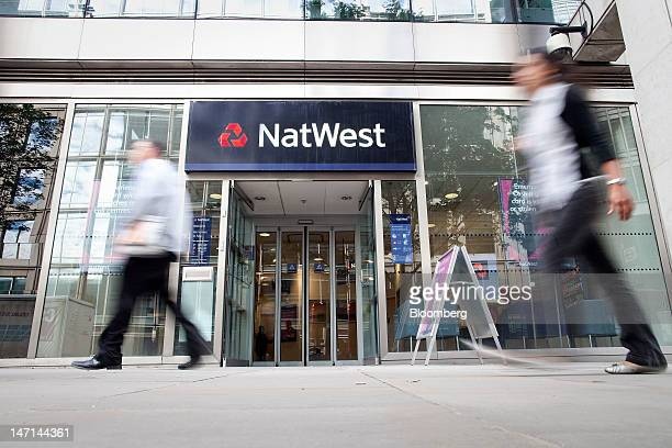 Pedestrians pass a NatWest bank branch a retail unit of Royal Bank of Scotland Group Plc in London UK on Tuesday June 26 2012 Royal Bank of Scotland...