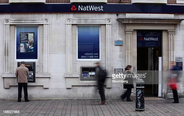 Pedestrians pass a NatWest bank branch part of the Royal Bank of Scotland Group Plc in Staines UK on Tuesday Dec 18 2012 The European Union is...